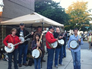 A group of banjo players get ready to join Wiregrass bluegrass band to kick off the 4th annual Rhythm & Roots Run